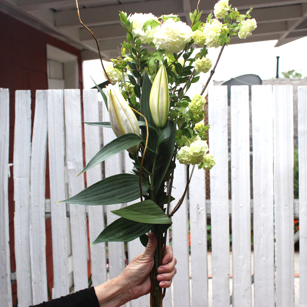 Make a bouquet adding lily and viburnum.