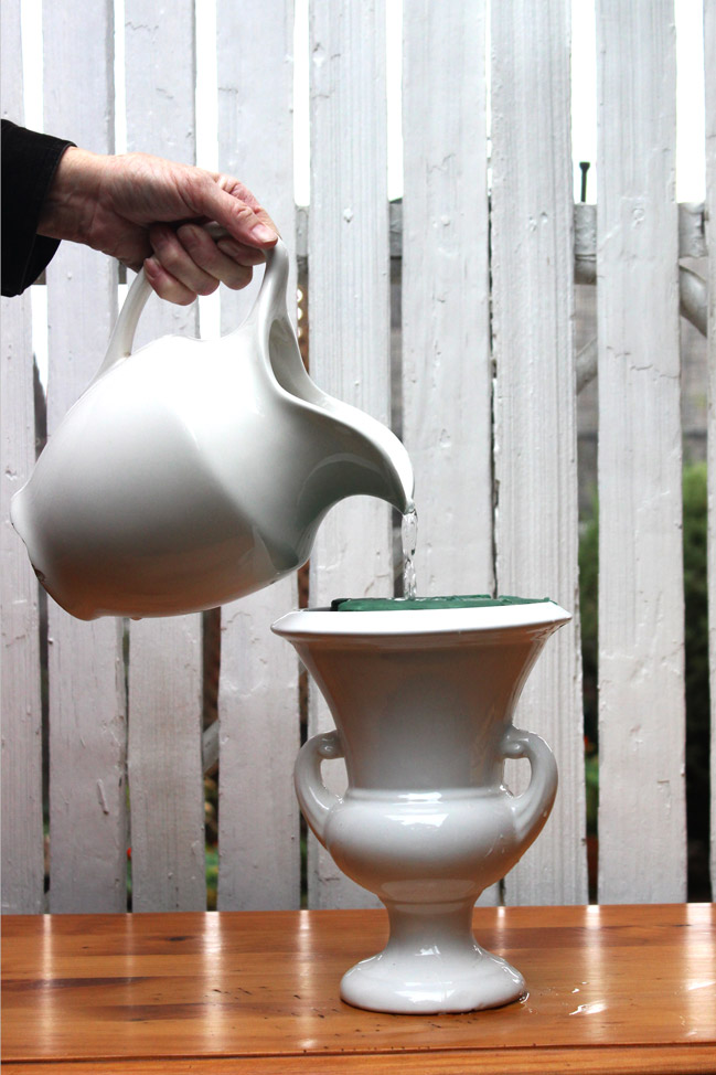 Fill pitcher with water until it won't accept any more.  It will take a  lot!