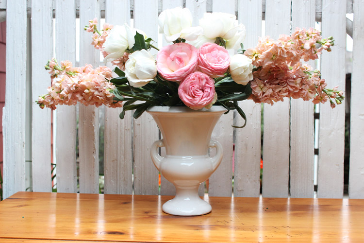Put 3 pink garden roses in front, low, as focal point.
