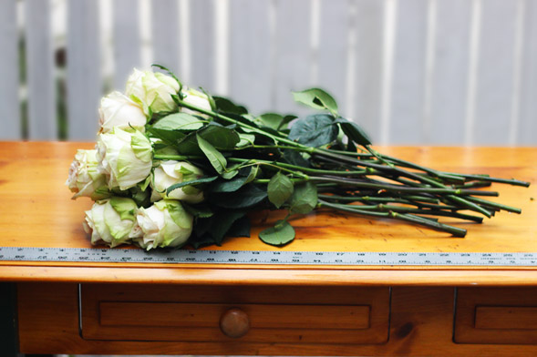 Start grouping your bouquet on a table.