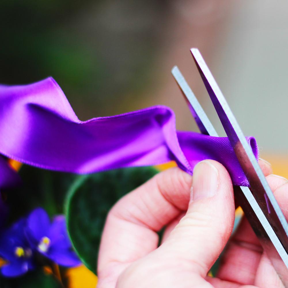 Cut a V in each ribbon end.