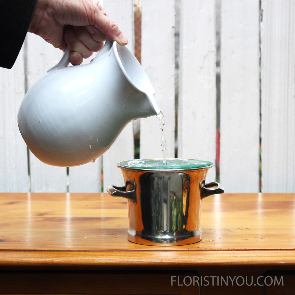 Pour water into the urn until it stops taking it.  It will drink a lot.