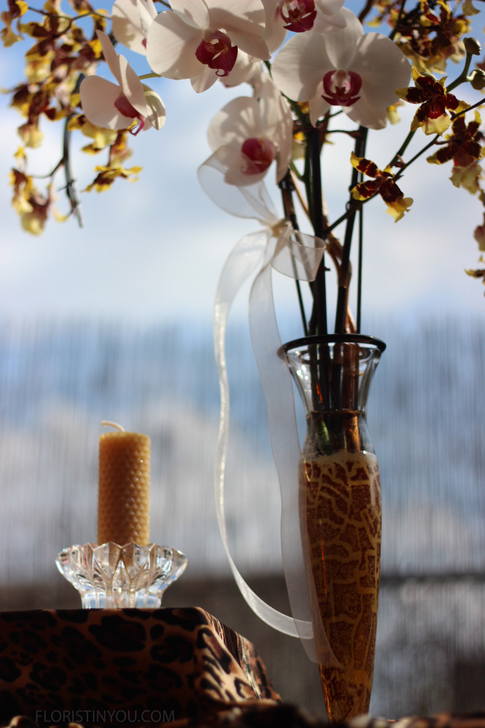 Tie a sheer ribbon on one of the supports or orchid stems.  Cut the ends at a 45 degree angle with sharp fabric scissors.