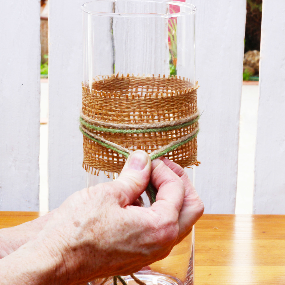 Start in the front of the vase.  Wrap to the back and bring it around to the front again.