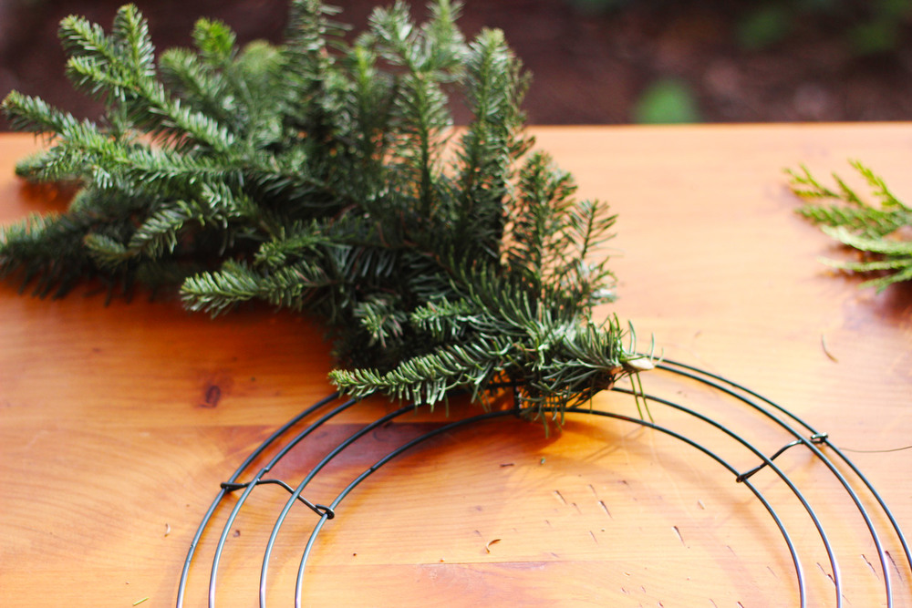 Cut all branches the same length.  I recommend 6 inches or 9 inches.  Take a group of 2 or 3 and wrap the wire around the bottom 5 or 6 times.