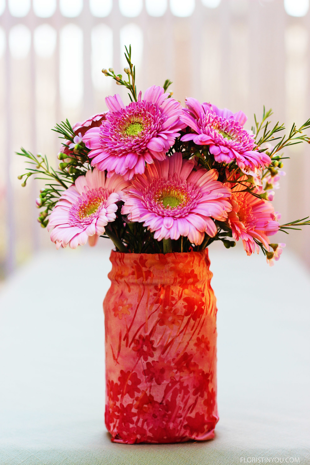 Gerber Daisies and Wax Flowers