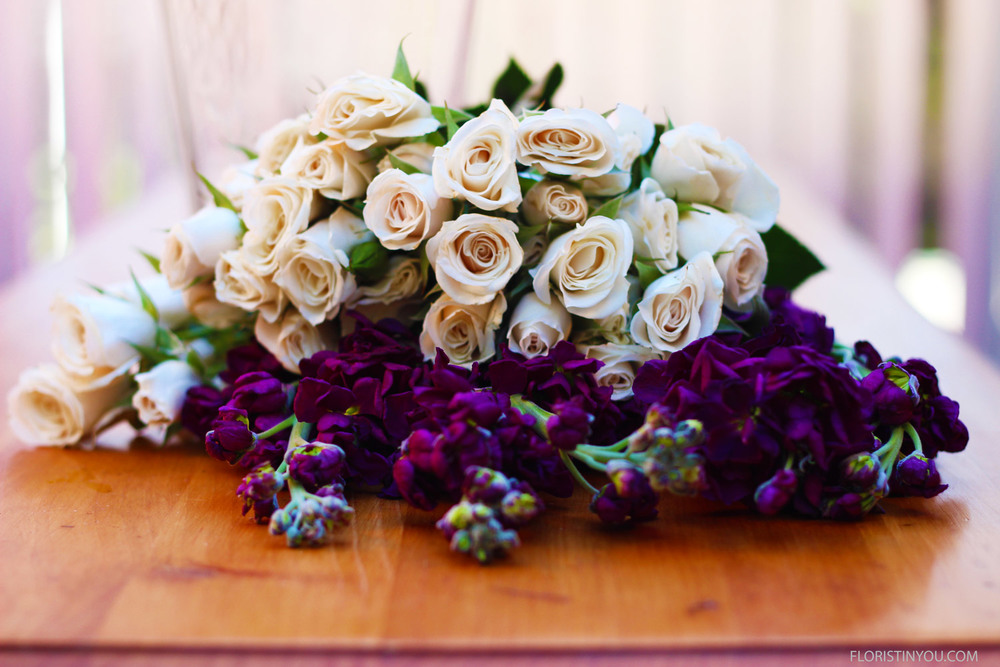 Here are the white Spray Roses and lavender Stock.