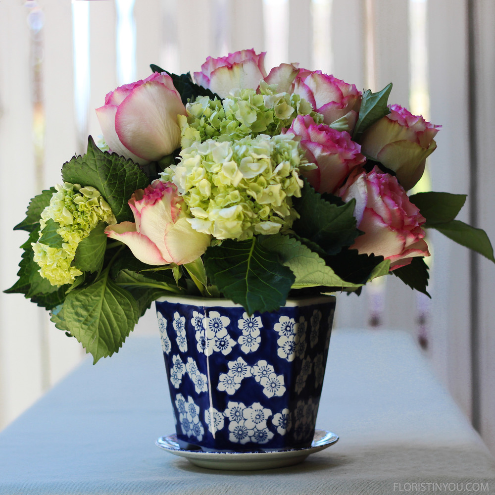 Cut hydrangea 8.5 inches.  Place center front.  Cut rose 9 inches place front left, and cut another rose 9 inches. Place in back.