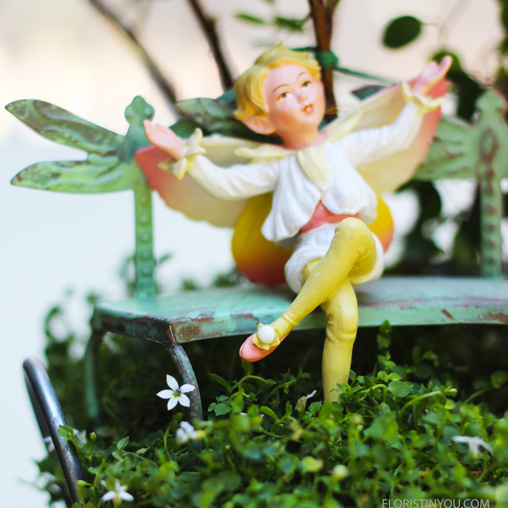 Place fairy on bench. You can secure with floral putty.