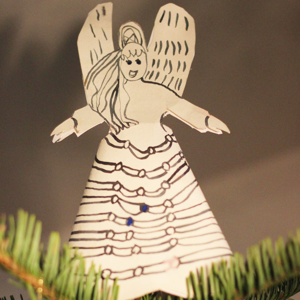 Have your kids paint a watercolor angel topper and ornaments.