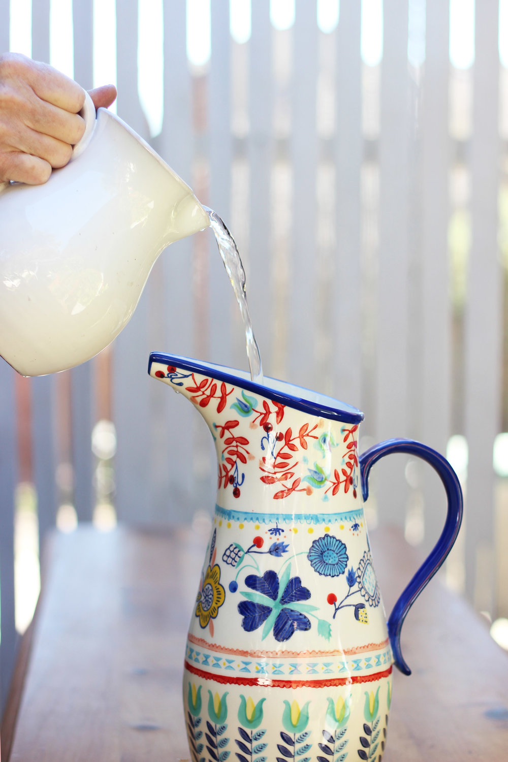 Fill pitcher with water to 2 inches below the top.