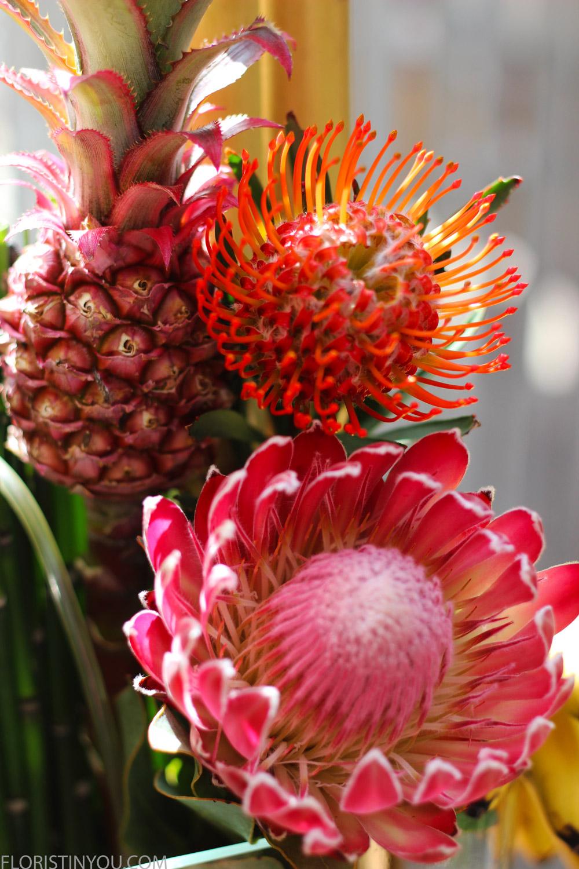 Put in large bamboo, pineapple, orange pincushion protea, and fushia protea to right.