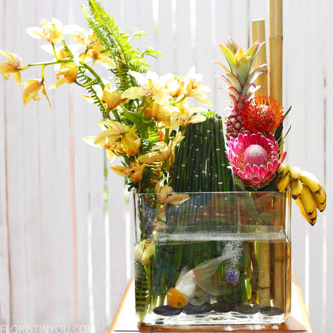 You are finished with this very large dramatic exotic floral arrangement with a fancy goldfish.  Enjoy!