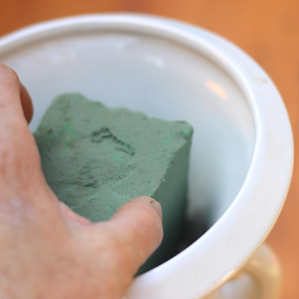Push foam down into bottom of vase.