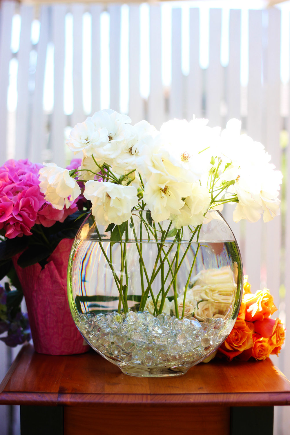 Start by placing Iceberg Roses in vase with stems straight down.