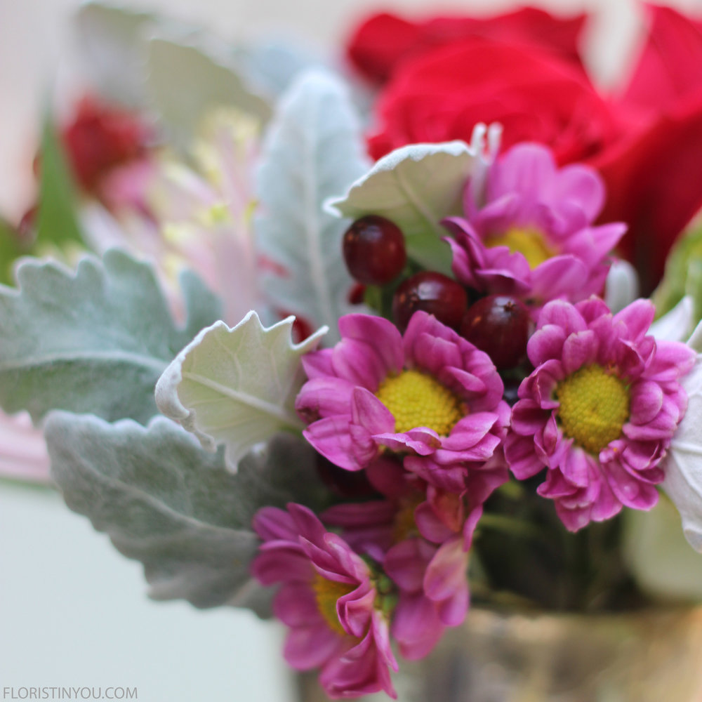 Love the fuzzy Dusty Miller, red berries and fucshia daisys.