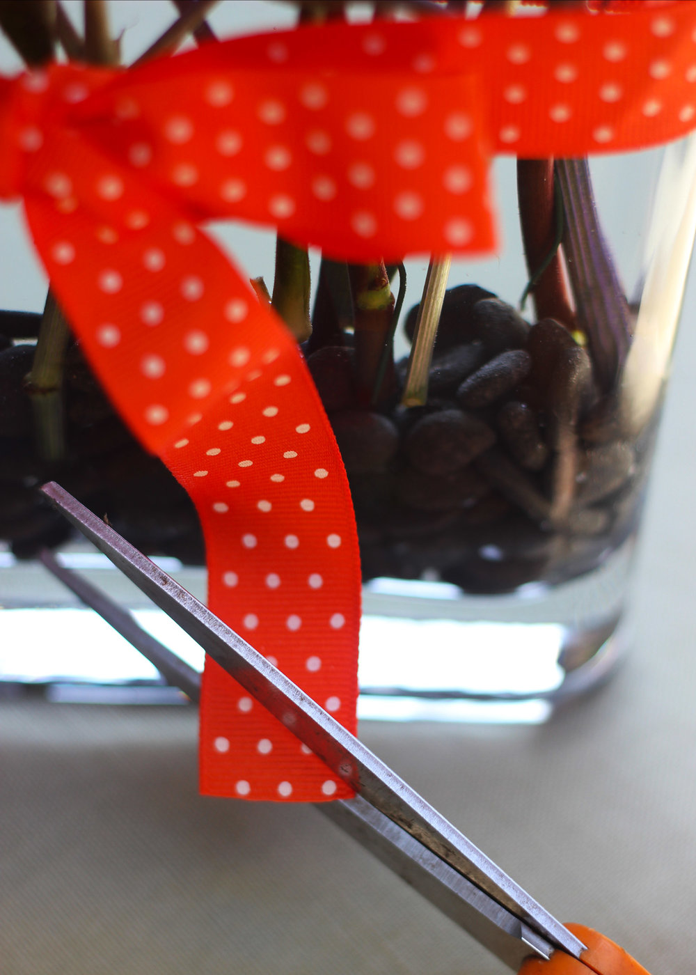 Tie ribbon tight in a knot then a bow.  Cut edges at a 45 degree angle.
