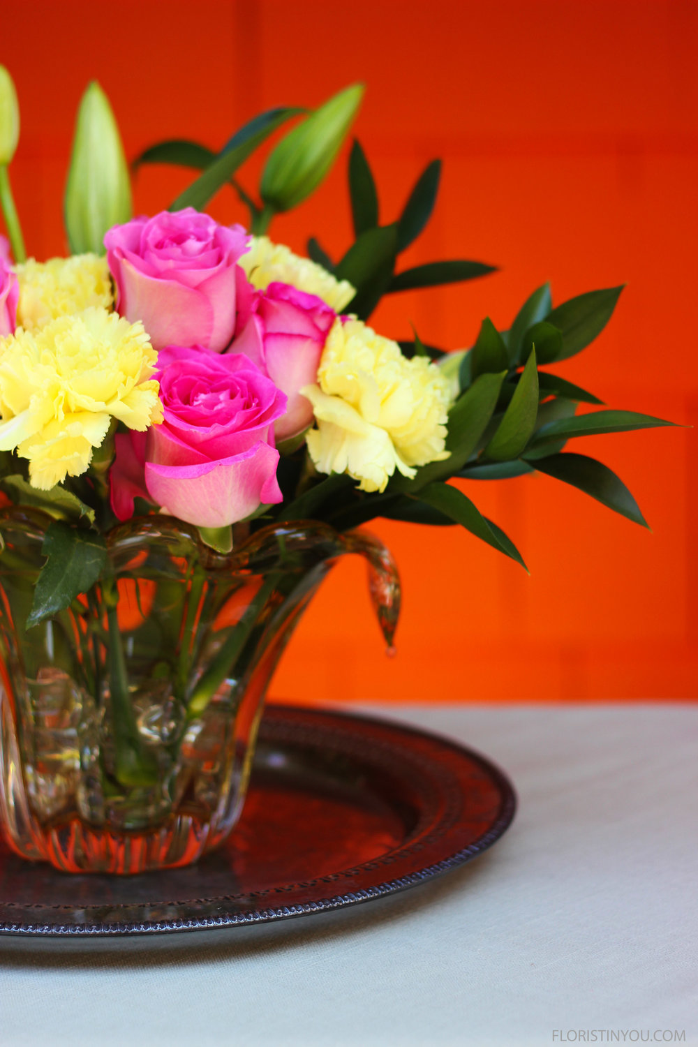 For this size vase, re-cut carnations about 7.25 - 8.25 inches.  Set arrangement on silver tray.