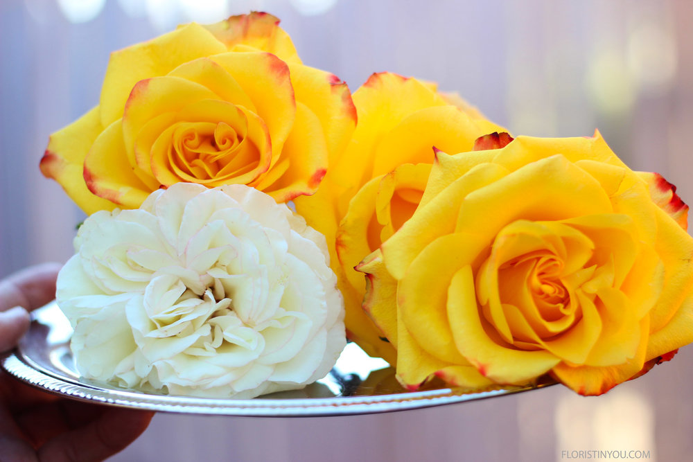 And here are your large yellow roses and white David Austin Rose.