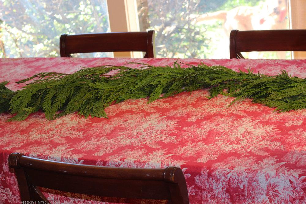 Lay fresh garland in serpentine curve.