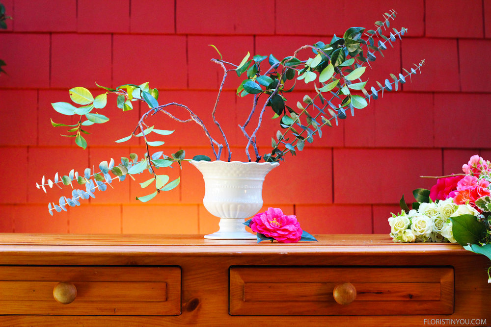 Make base with Eucalyptus leaves & Jasmine Vine on a 45 degree angle.