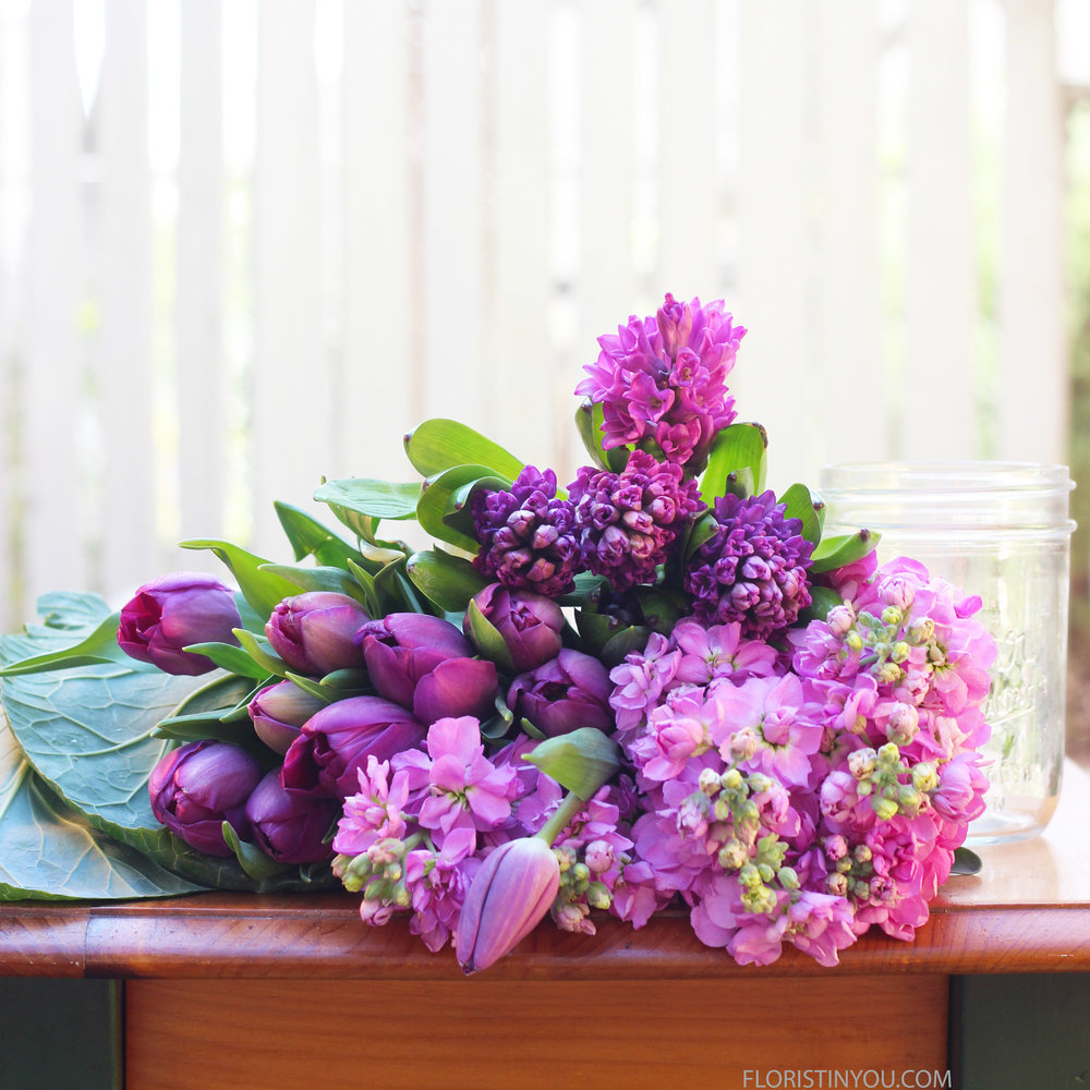 These are the flowers, greens, and Mason jar that you will use.