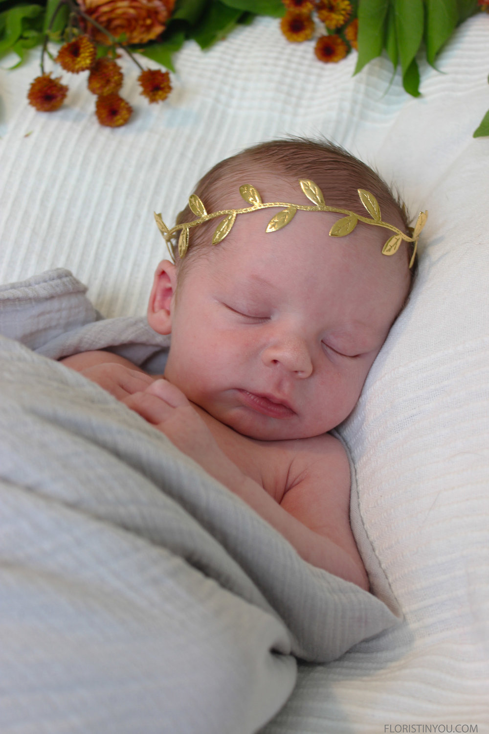 You can swaddle baby and take your newborn photos while baby sleeps. They are not this small very long. Enjoy!