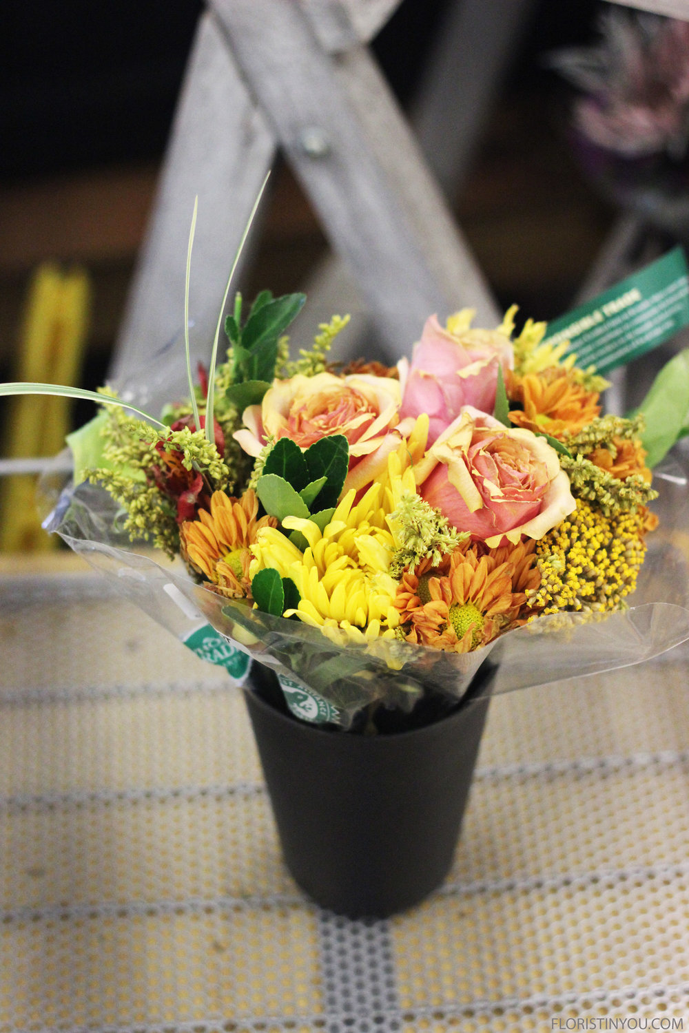 Take the flowers from a Petite Grocery Store Bouquet.