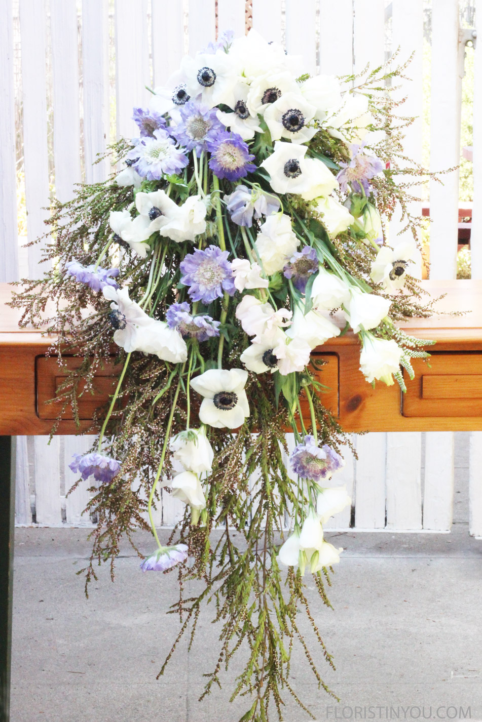 Add white Lisianthus, Sweet Pea, Veronica and  Roses.