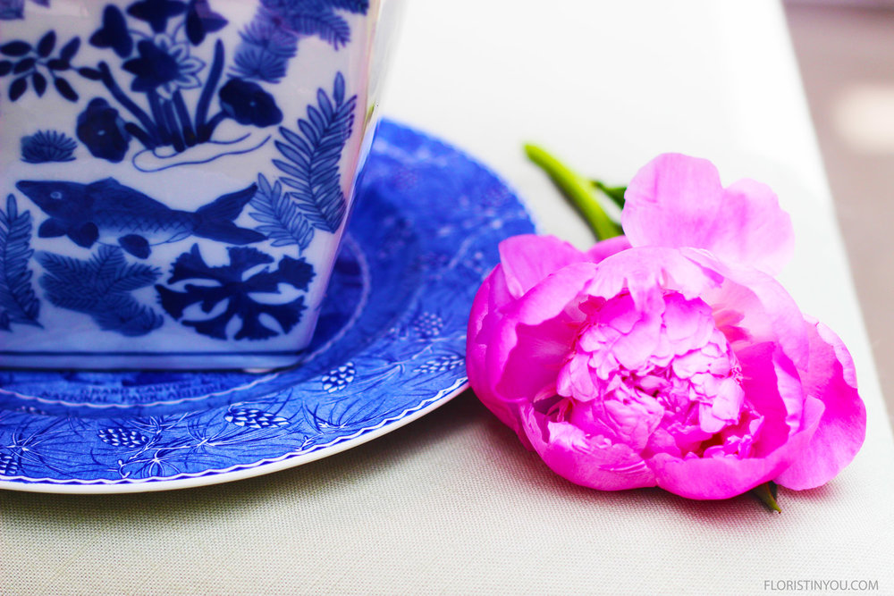 The fucshia color is incredible with the blues in this blue and white china.