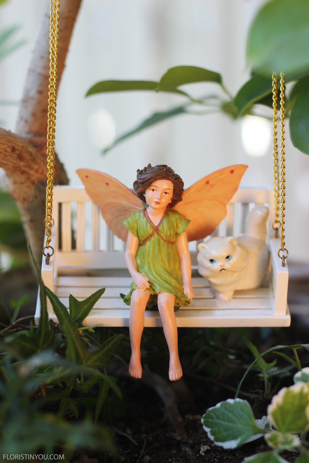 The Apple Blossom Fairy has auburn hair and a neo-classical dress.