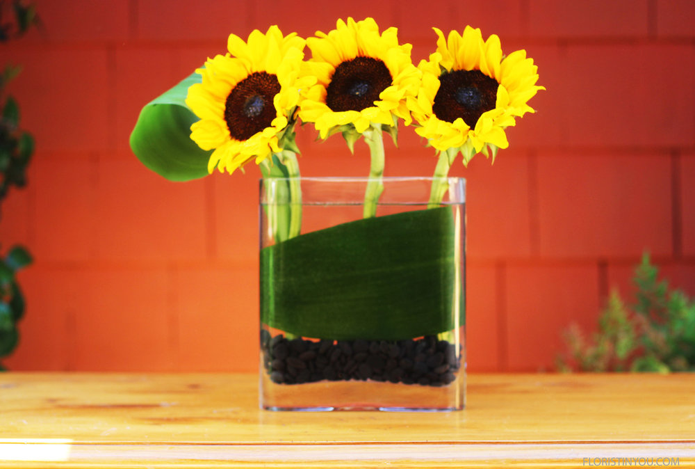 Add 3 sunflowers with stems straight.