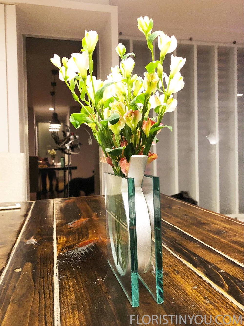 This is a side view of the MoMA Ribbon Vase on the dining table.