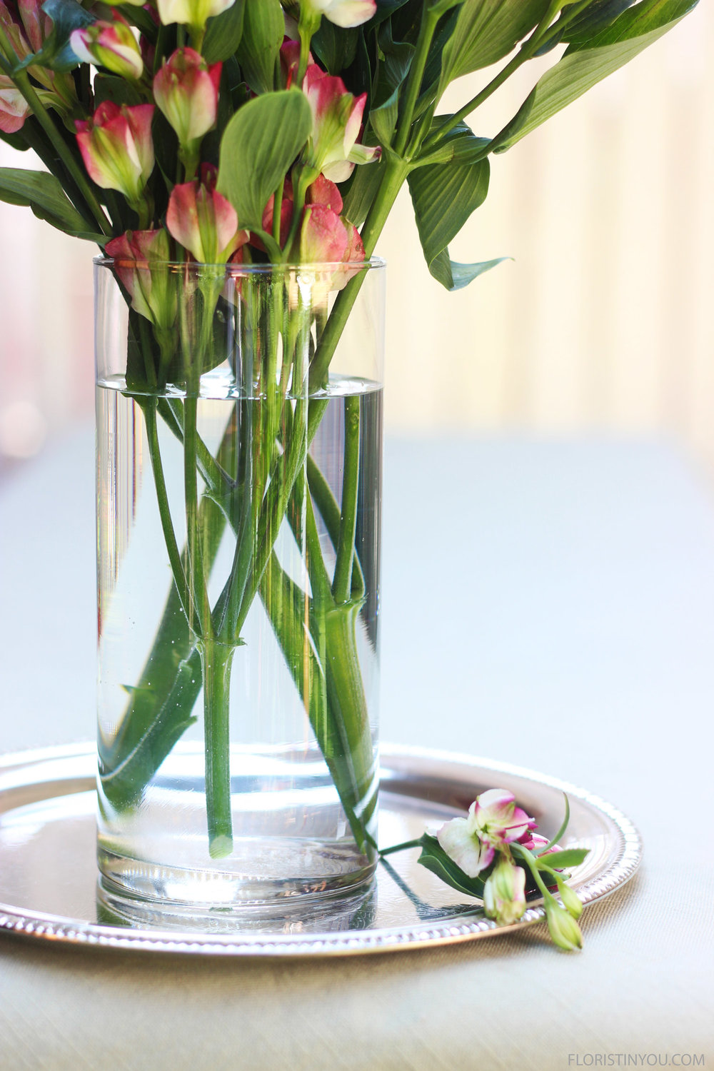 The stems crossing is part of the clean design of this arrangement.