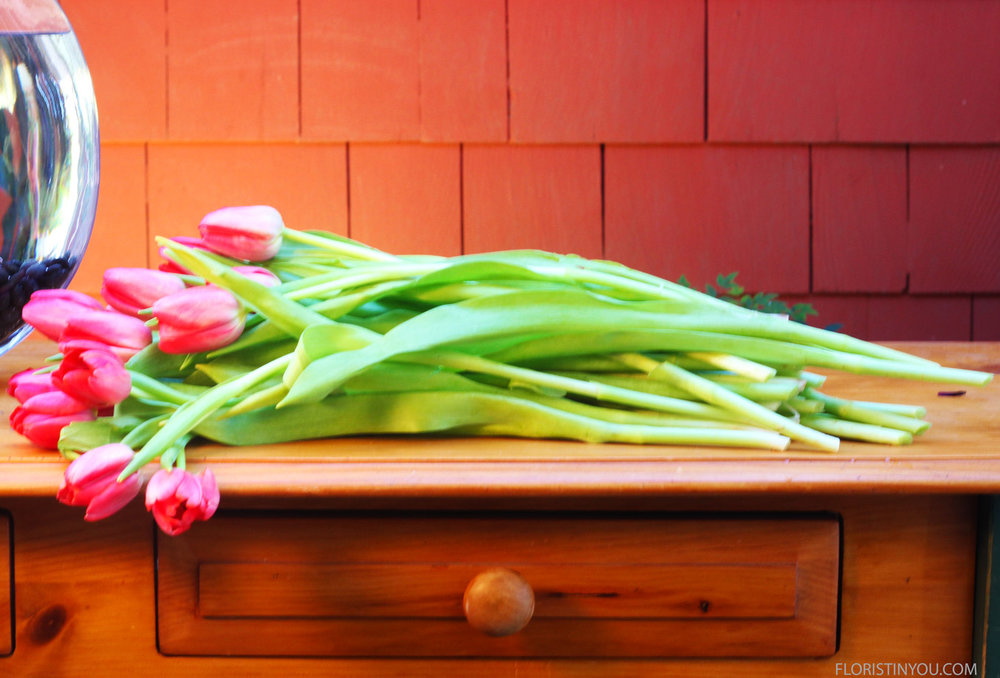 Lengthen tulips with longest on the left side gradually getting shorter to the right.