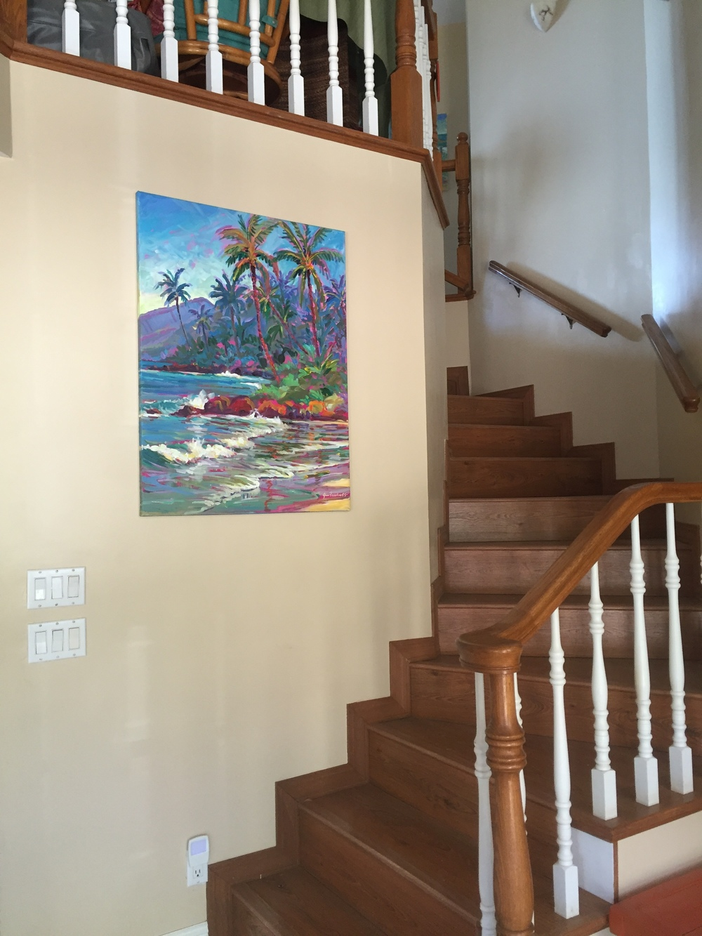 This is the view now. A warm beige color and a painting by our friend, Jimmy Freeheart adorns the wall. All of our guest rooms are located upstairs and there's a landing area above that serves as our early morning coffee service and snack space.
