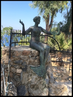Beautiful mermaid sings a song of the sea, welcoming climbers and seafarers to Massouri