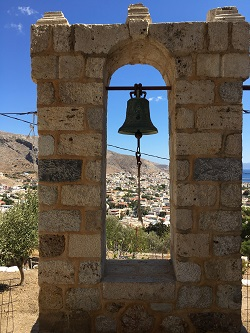A bell at a Church built by the Knights.     The crystalline sea in the background.