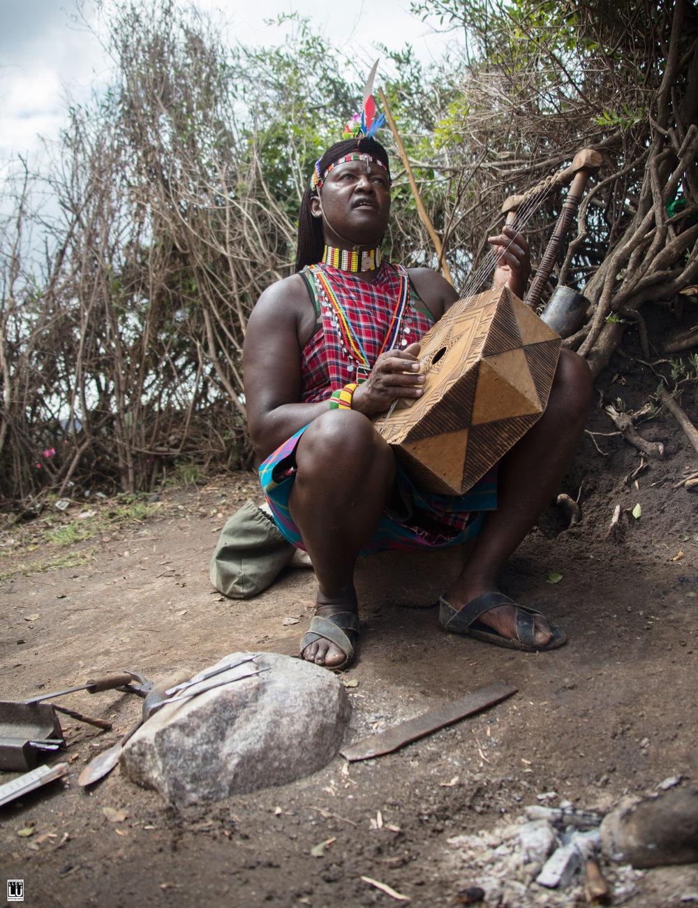 The blacksmith sang and played me a song on his Nyatiti.