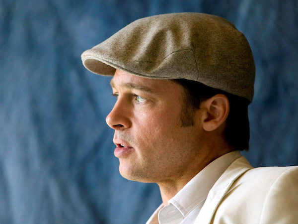 Brad Pitt wears his signature newsboy style Kangol hat. Photo by modernmancollection.com.