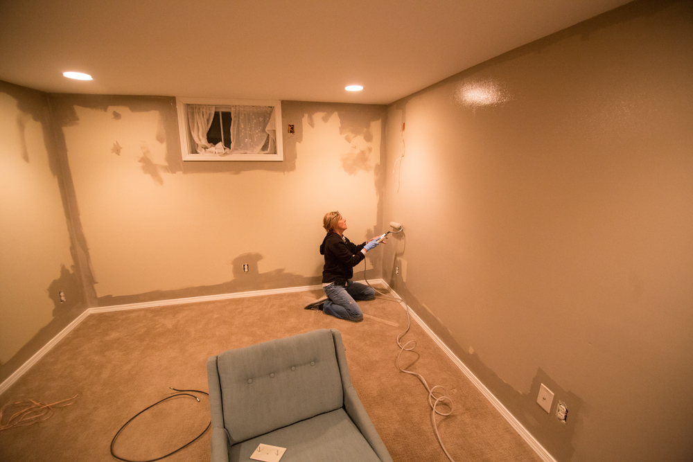 My aunt Mary came to help and painted the whole basement's first coat by herself.  Thanks Mary!