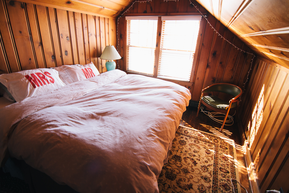 I love the cabin-feel to our master bedroom.  Even though in the winter it gets freezing cold up there and in the summer it gets sauna-hot.  PTL for window AC's.