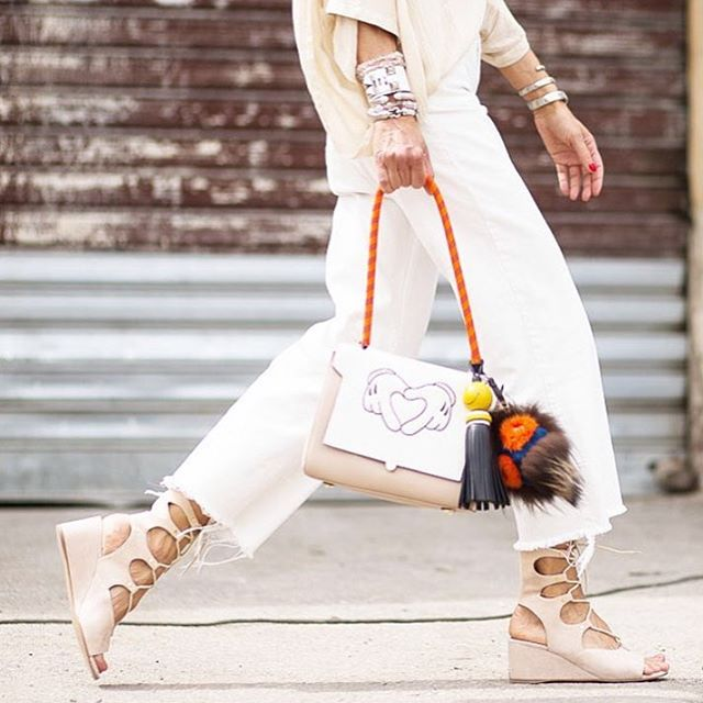 A combination of all our favorite accessories topped with an all-white outfit. #streetstyle #ootd #anyahindmarch #london #bag #fendi #milan #chloe #paris #wedges #hermes #cuff #style #trends #wvf #dubai