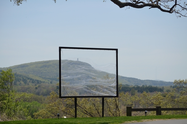 Ode to Talcott Mountain, 15x15', steel, fishing net,  2014. Netting can be woven into with wool, hay, feathers for example, to create a textural billboard.