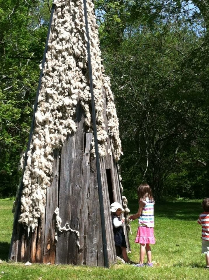 courtesy of Heritage Museum. Children playing inside  Wing's Spire,  a nod to the original family homestead.