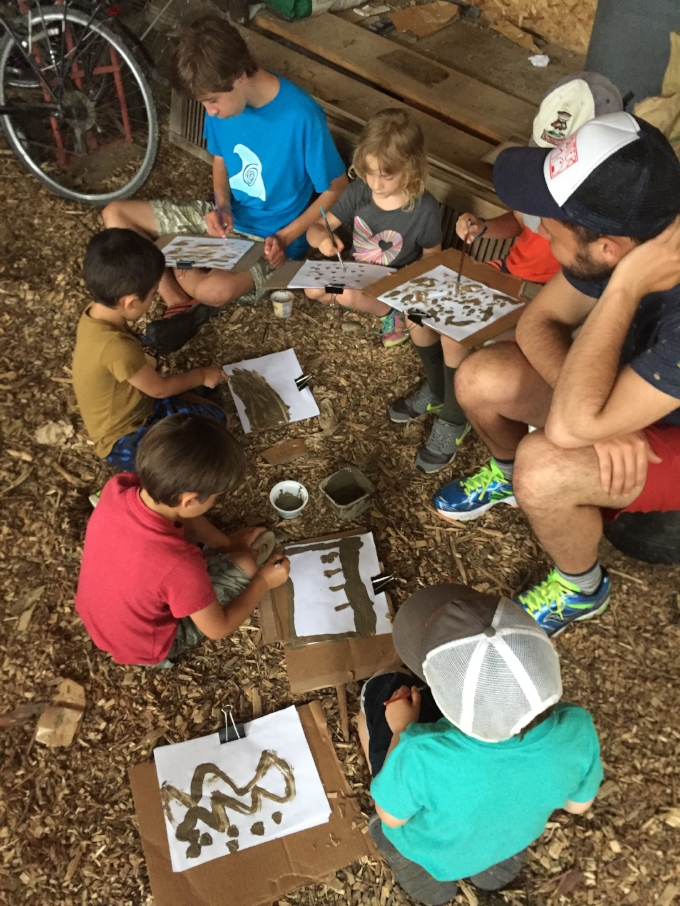 Campers at Camp Bread and Butter paint with earth guided by Gabrielle Rosenbacher and Eleanor Reagan as part of Nancy Winship Milliken Studio environmental art internship program