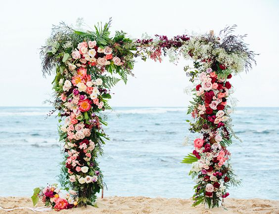 Floral Arch: Arch design with tropical greenery. Florals to be in floral color palette of whites &purples.