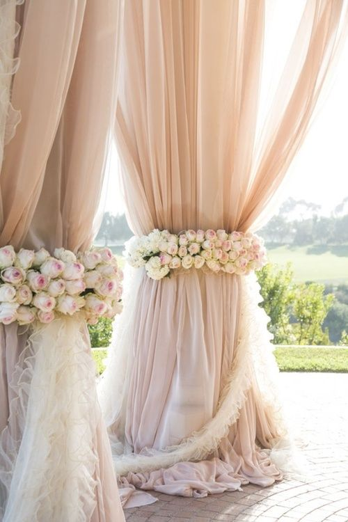 Tent side poles to be covered in heavy draping with florals around centers.
