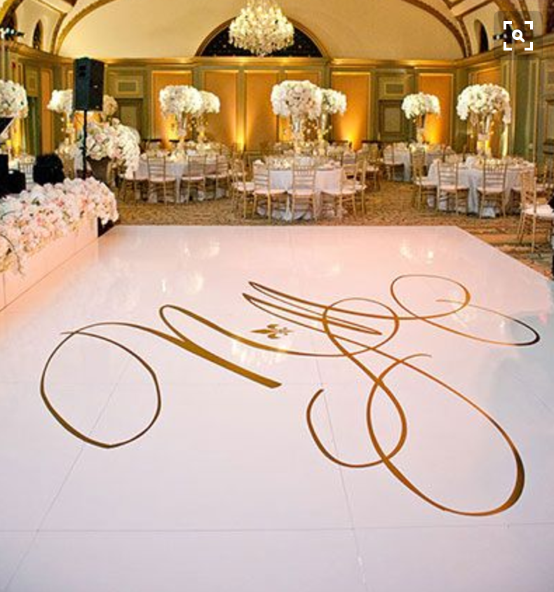 Floral Boxes in front of dance floor. White Dance floor with gold monogram vinyl decal.