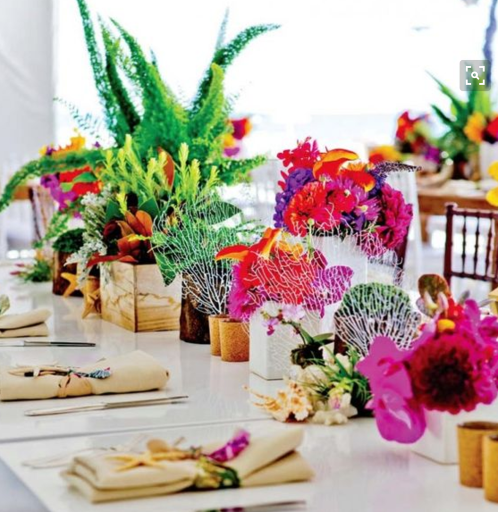 Tropical Table settings on white bamboo tables.
